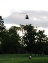 golf ball drop helicopter hovers at 9th hole