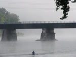 morning rower heading toward CSX rail bridge and more fog –21Sep09