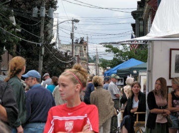 Stockade Art Show crowd under threatening skies on N.Ferry St. - 12 Sep09