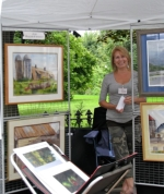 the rain doesn't faze artist Judy Haller D'Angelo under her canopy