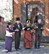 Walkabout 2009 - strolling singers stop at the Teller House, 121 Front St.
