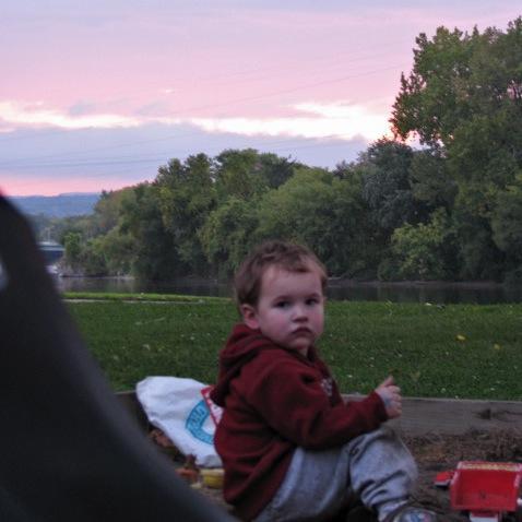 swingset sunset - Devin wants to stay at Riverside Park a little longer - 03Oct09