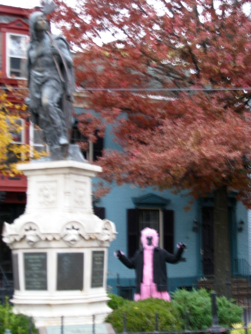 large pink creature sneaks up on Lawrence, Halloween 2009 in the Schenectady Stockade