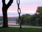 swingset sunset – end phase from swingset, Riverside Park, Schenectay –03Oct09