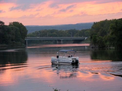 swingset sunset - flatbottom boat approaching Isle of the Cayugas, Mohawk River - 03Oct09