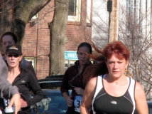 women pass Cucumber Alley on Washington Ave. - Stockade-athon