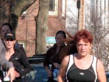 women pass Cucumber Alley on Washington Ave. - Stockade-athon