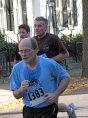 three men run up Front St. - Stockade-athon 2009