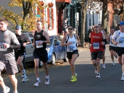 runners passing N. Ferry St. on Front St. - Stockade-athon 2009