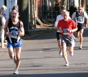 two runners pass Lawrence Circle in light and shadow - Stockade-athon 2009