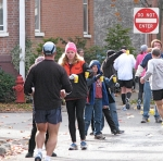 runner stops at water station on the corner of Washington Ave. and Union St. in the Schenectady Stockade - Stockade-athon 2010 -07Nov2010