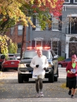 runners #730 and 81 lead the rear escort police cruiser up Front St. toward Washington Ave. in the Schenectady Stockade - Stockade-athon 2010 - 07Nov2010
