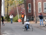 a contestant on a three-wheeler is about to turn from Front St. onto Washington Ave. (at Cucumber Alley) in the Schenectady Stockade - Stockade-athon 2010 - 07Nov2010