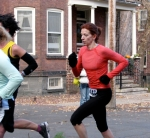 a runner in orange turns the corner from Front St. to Washington Ave. heading south in the Schenectady Stockade - Stockade-athon 2010 - 07Nov2010