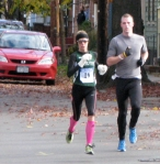 runner #16 [Lori Kingsley of Wysox, who finished 4th in the Women's Division] is the first woman runner (seen by the photographer) entering the Lawrence Circle in the Schenectady Stockade - Stockade-athon 2010 - 07Nov2010