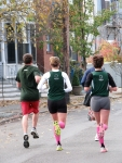 four runners including #17 [Eileen Combs] & #18 [Emily Bryans] head west up Front St. toward N. Church St. after passing the Lawrence Circle - Stockade-athon 2010 - 07Nov2010