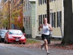 runner #14 on Front St. heading west approaches Lawrence Circle in the Schenectady Stockade - Stockade-athon 2010 - 07Nov2010