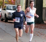 Runners #5 [Andy Allstadt of Albany, who later won the race] and #2 [Tim Chichester of Mount Morris, who finished the race in 2nd place] are the first to reach the Lawrence Circle - Stockade-athon 2010 - 07Nov2010