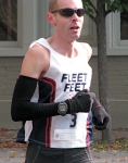Runner #3 [Mark Andrews of Rochester, who finished the race in 5th place] reaches the Lawrence Circle - Stockade-athon 2010 - 07Nov2010
