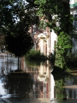 homes on the east side of Washington Ave. are reflected on Irene flood waters near the Mohawk River in the Schenectady Stockade - 5 PM 29Aug2011