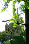 Saint George's Episcopal Church steeple seen behind the newly hung sign for the Stockade Home Market - 35 N. Ferry St. in the Schenectady NY Stockade - 20Oct2011