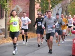 runners 1121 & 324 lead a large group of runners near the Lawrence Circle at the halfway point of the race in the Schenectady Stockade  - Stockade-athon 2011 - 13Nov2011
