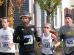 runners # 655, 427, 1615 and 425 about to enter the Lawrence Circle at the halfway point of the race in the Schenectady Stockade  - Stockade-athon 2011 - 13Nov2011