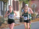 runners #18 and 21 entering the Lawrence Circle at the halfway point of the race in the Schenectady Stockade  - Stockade-athon 2011 - 13Nov2011
