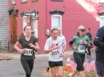 Stockade-athon 2011 runners turning the corner onto Washington Ave. at Front St. - Schenectady NY Stockade - 13Nov2011