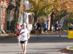 a view of Stockade-athon 2011 runners looking east on Front St. from Lawrence Circle - Schenectady NY Stockade - 13Nov2011