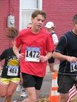 a younger Stockade-athon 2011 runner heads up Washington Avenue - Schenectady NY Stockade - 13Nov2011
