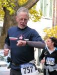 runner 575 check the time midway through Stockade-athon 2011 - Schenectady NY Stockade - 13Nov2011