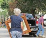 Sylvie Spradlin hurries to pack up before the expected storm