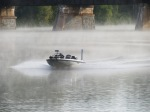 fishing over a boat speeds away from the fog surrounding the CSX trestle - seen from the Esplanade in Riverside Park along the Mohawk River on a foggy morning - Schenectady NY - 20Sep2012