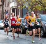 runners #1147 (Matt Oberst), 416 (Marcus Debergh), 264 (Eric Carman) and others approach Lawrence Circle on Front St. - Schenectady NY Stockade - Stockade-athon 2012 - 11Nov2012