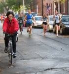 runners and a bicyclist approaching Lawrence Circle halfway point - Schenectady NY Stockade - Stockade-athon 2012 - 11Nov2012