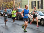 runners ##1319 (Jon Ricciardi), 233 (Jeffery Budka), 1818 (Joe Grabicki) and 9 (Emily Bryans, who placed 7th) on Front St. near Lawrence Circle Schenectady NY Stockade - Stockade-athon 2012 - 11Nov2012