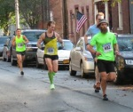 runners 482 (Craig Dubois), 639 (Daniel Gracey), 1139 (Grant Norton) on Front St.  - Stockade-athon 2012 - Schenectady NY Stockade - 11Nov. 2012