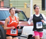 runners #162 and 86 nearing the Lawrence Circle on Front St. - Stockade-athon 2012 - Schenectady NY Stockade - 11Nov. 2012