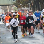 runners #790, 428, 943, 1783 lead many others on Front St. - Stockade-athon 2012 - Schenectady NY Stockade - 11Nov. 2012