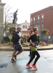 runners passing Lawrence the Indian heading up Front St. Schenectady NY Stockade - Stockade-athon 2012 - 11Nov2012