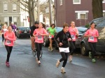 runners in pink (1570, 871, 473, 9210 and others heading up Front St. past Lawrence Circle Schenectady NY Stockade - Stockade-athon 2012 - 11Nov2012