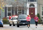 two runners outpace the rear escort cars on Front St. - Schenectady NY Stockade - Stockade-athon 2012 - 11Nov2012