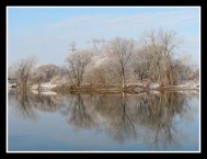 Isle of the Cayugas seen across the Mohawk River from the end of Cucumber Alley in the Schenectady NY Stockade