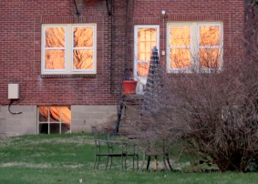windows on the rear first floor of 10 Washington Ave. in the Schenectady NY Stockade at sunset, seen from along the Mohawk River - 18Apr2013