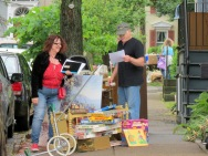 event coordinator Diane DeMeo makes sure Bob Hayner has all the right papers for his last Stockade Sidewalk Sale