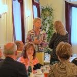 Pat Mett [standing, center] chats with Pam Menton [R] – FCSS Golf Ball Drop –13Sep2013