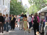 exhibitors and visitors filled up Front Street under variable skies
