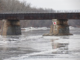 scene showing piers of the CSX trestle over the Mohawk River looking east from Riverside Park in Schenectady NY about 9 am on 12Jan2014