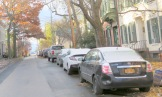 Washington Ave. at Cucumber Alley, with season's first dusting of snow on cars